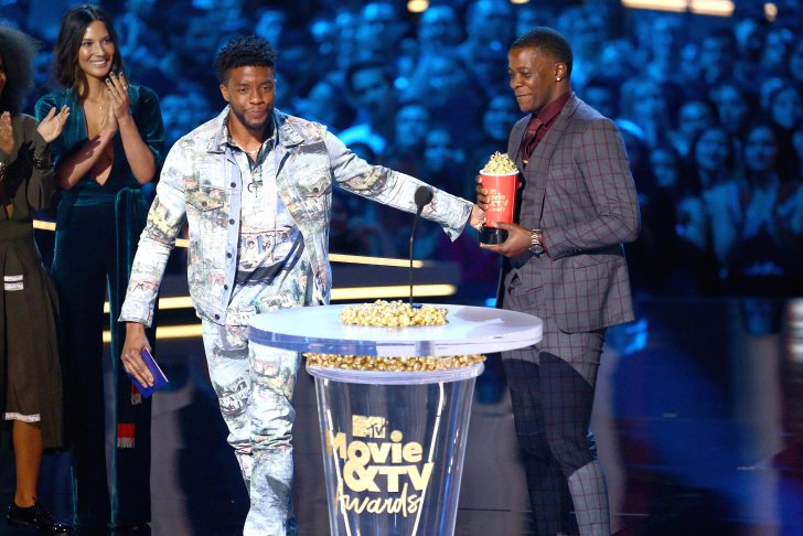 SANTA MONICA, CA - JUNE 16: James Shaw Jr. (R) accepts the Best Hero award presented to him by 'Black Panther' actor Chadwick Boseman (L) onstage during the 2018 MTV Movie And TV Awards at Barker Hangar on June 16, 2018 in Santa Monica, California. (Photo by Rich Fury/Getty Images)