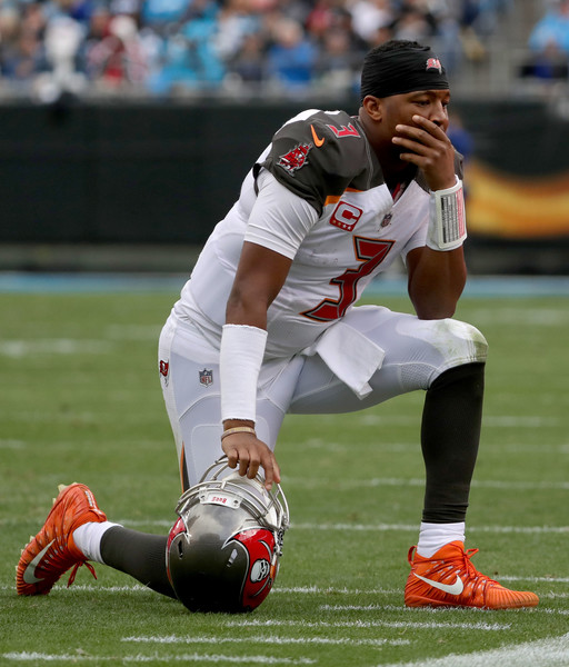 Jameis Winston #3 of the Tampa Bay Buccaneers reacts between plays against the Carolina Panthers in the fourth quarter during their game at Bank of America Stadium on December 24, 2017 in Charlotte, North Carolina.