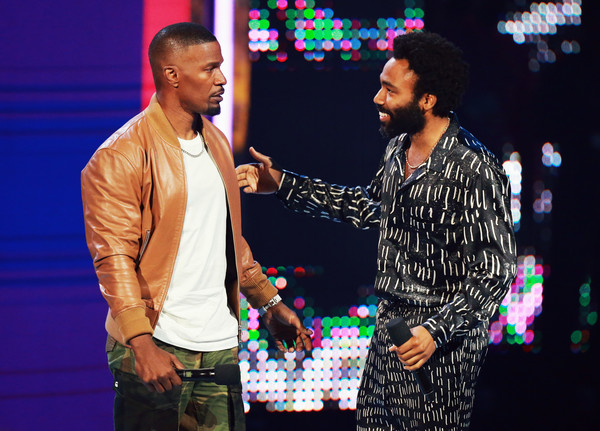 Host Jamie Foxx (L) and Donald Glover speak onstage at the 2018 BET Awards at Microsoft Theater on June 24, 2018 in Los Angeles, California.