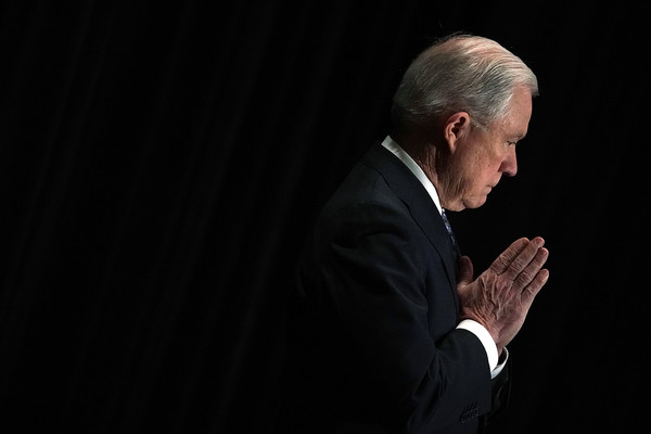 U.S. Attorney General Jeff Sessions listens as he is introduced during the Justice Department's Executive Officer for Immigration Review (EOIR) Annual Legal Training Program June 11, 2018 at the Sheraton Tysons Hotel in Tysons, Virginia.