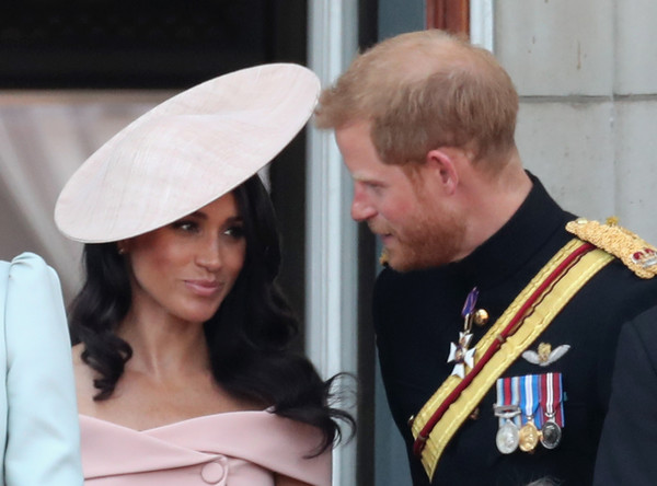 Meghan, Duchess of Sussex and Prince Harry, Duke of Sussex on the balcony of Buckingham Palace during Trooping The Colour on June 9, 2018 in London, England.
