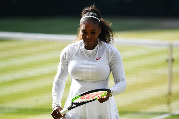 Serena Williams of The United States appears dejected during the Ladies' Singles final against Angelique Kerber of Germany on day twelve of the Wimbledon Lawn Tennis Championships at All England Lawn Tennis and Croquet Club on July 14, 2018 in London, England.