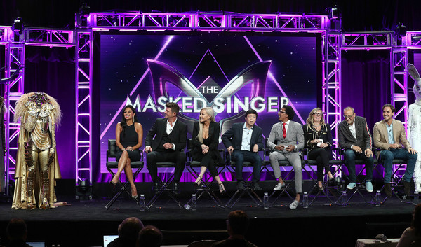 """(L-R) Nicole Scherzinger, Robin Thicke, Jenny McCarthy, Ken Jeong, Nick Cannon and producers of the television show """"The Masked Singer"""" speak during the Summer 2018 Television Critics Association Press Tour at the Beverly Hilton Hotel on August 2, 2018 in Beverly Hills, California."""
