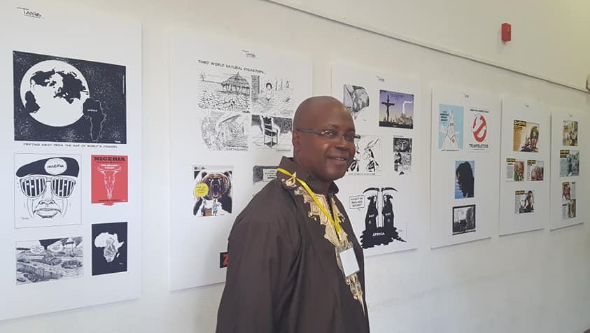 TAYO in front of his cartoons display @ Cinematheque Tel Aviv