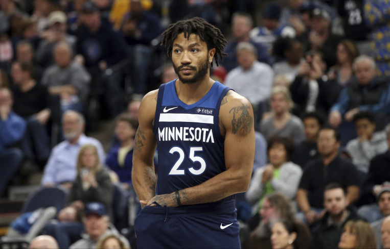Minnesota Timberwolves' Derrick Rose plays against the Golden State Warriors in an NBA basketball game Sunday, March 11, 2018, in Minneapolis. (AP Photo/Jim Mone)