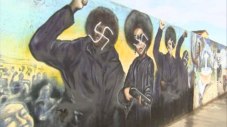 black panther mural defaced with nazi swastikas