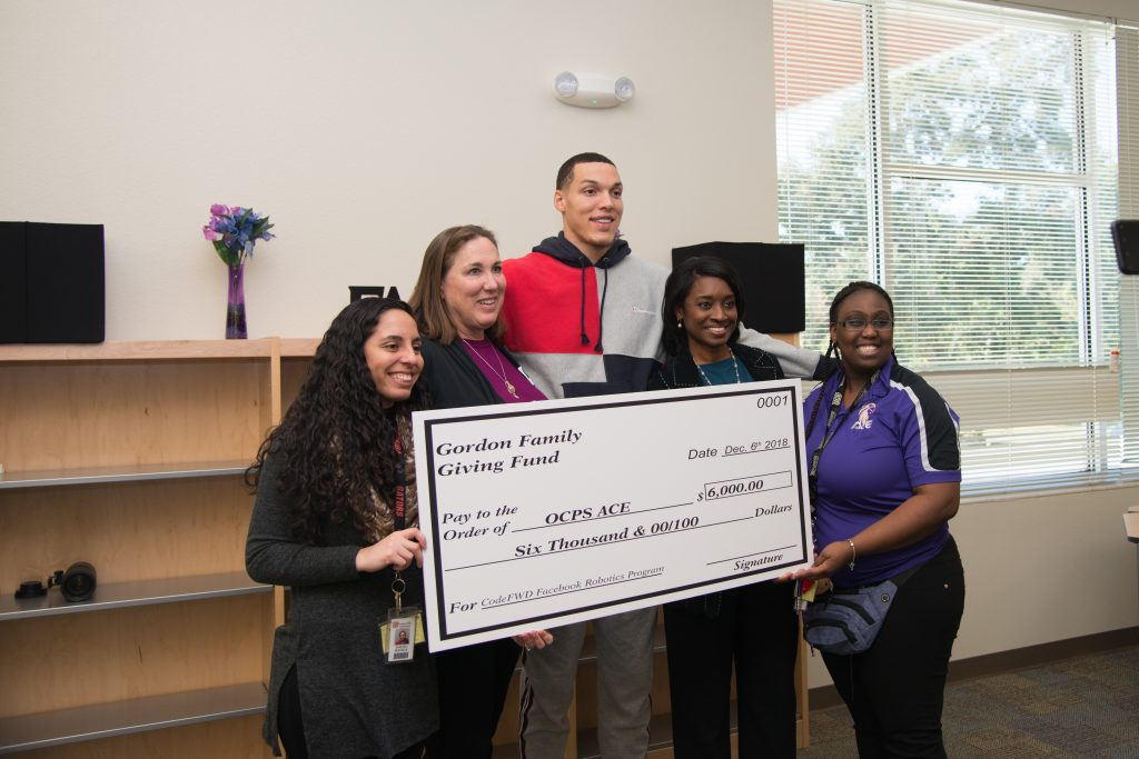 Yeseyka Davila-Anaya, OCPS ACE; Shelly Davis Gordon, Aaron's mom; Aaron Gordon, Magic forward; Shannon Currie community partnership school director; a representative from OCPS ACE
