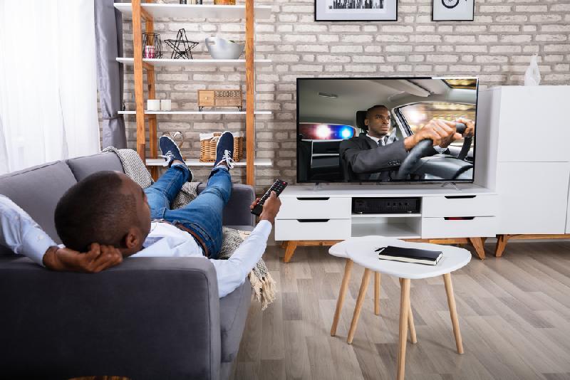 black dude watching TV