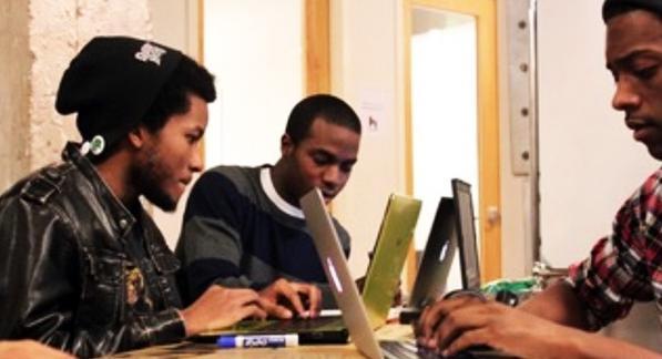 men at laptops