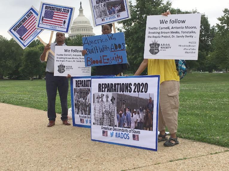 ados - reparations - outside congress - signs