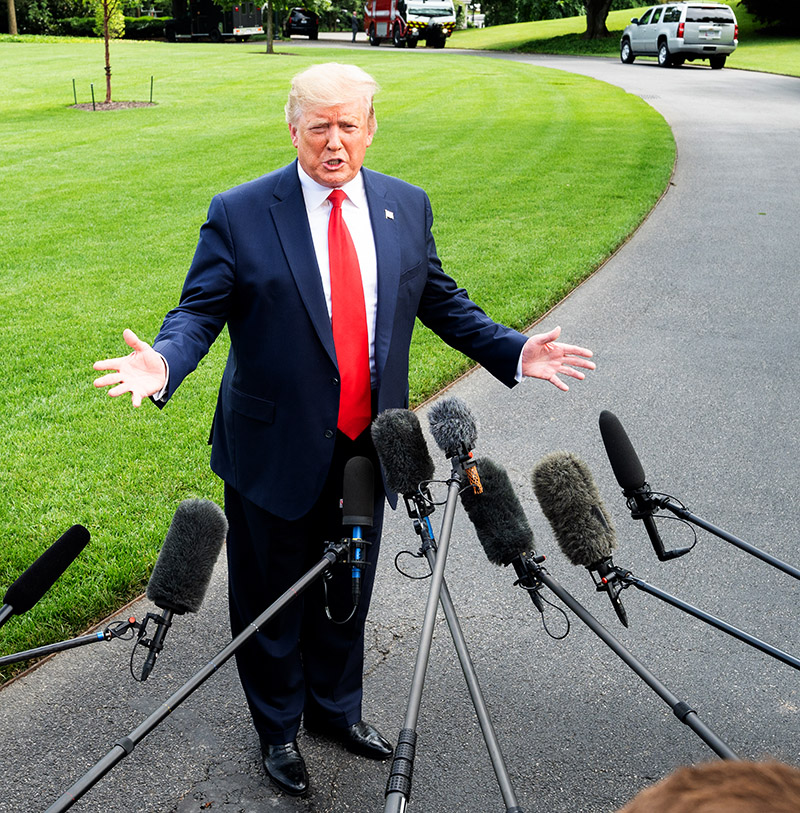 President Donald Trump talking with the press near the White