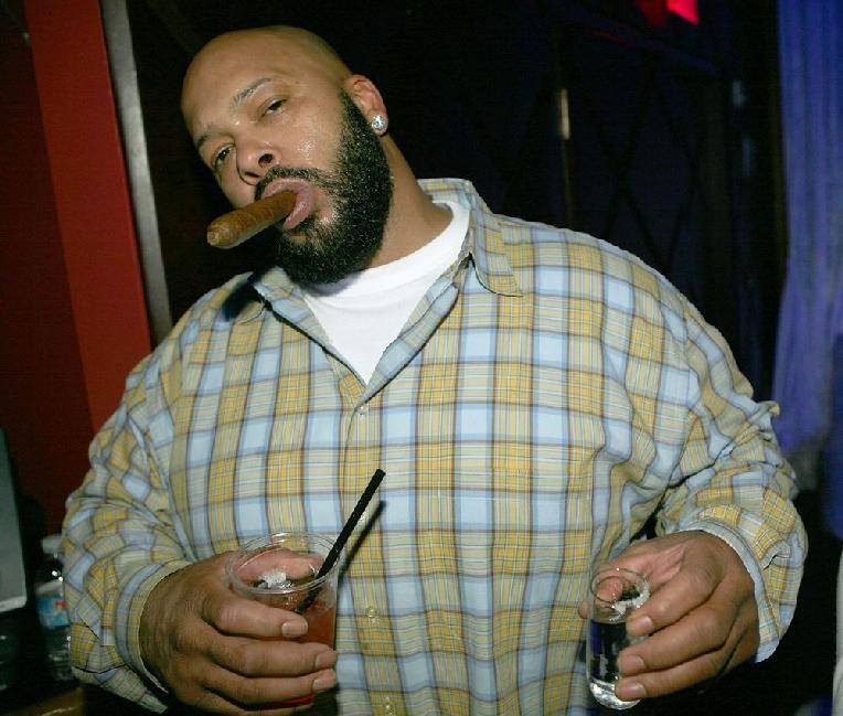 Suge Knight (drink cigar - getty)