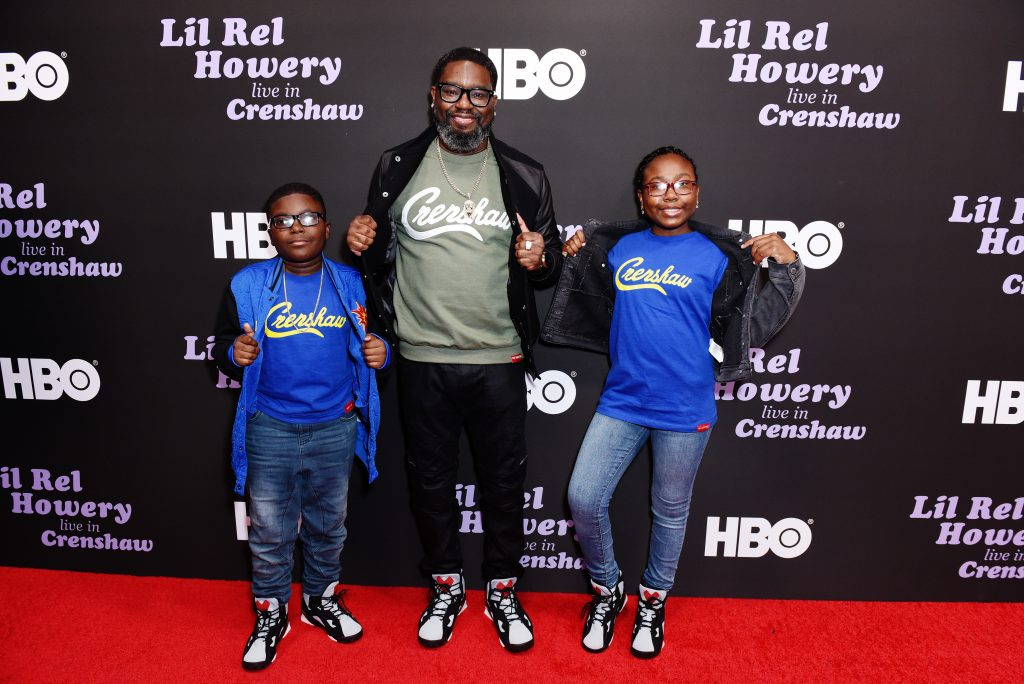 Lil Rel Howery (C) and family
