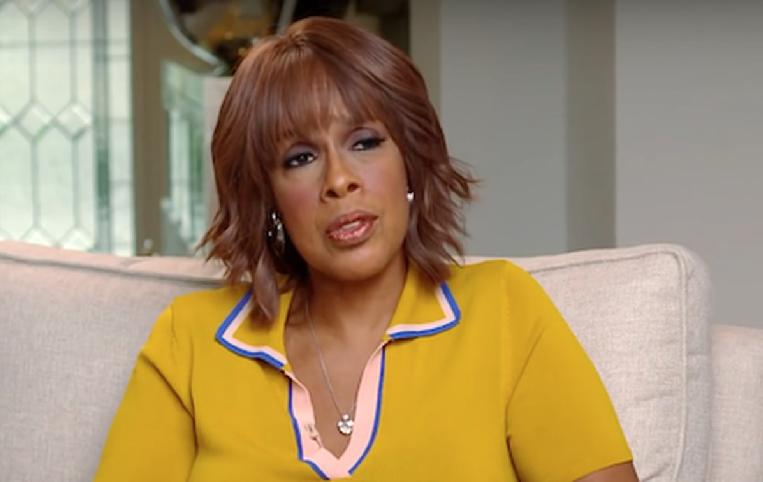 Gayle King (gold-yellow top)