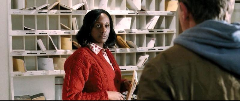 Karen Glave (red sweater)