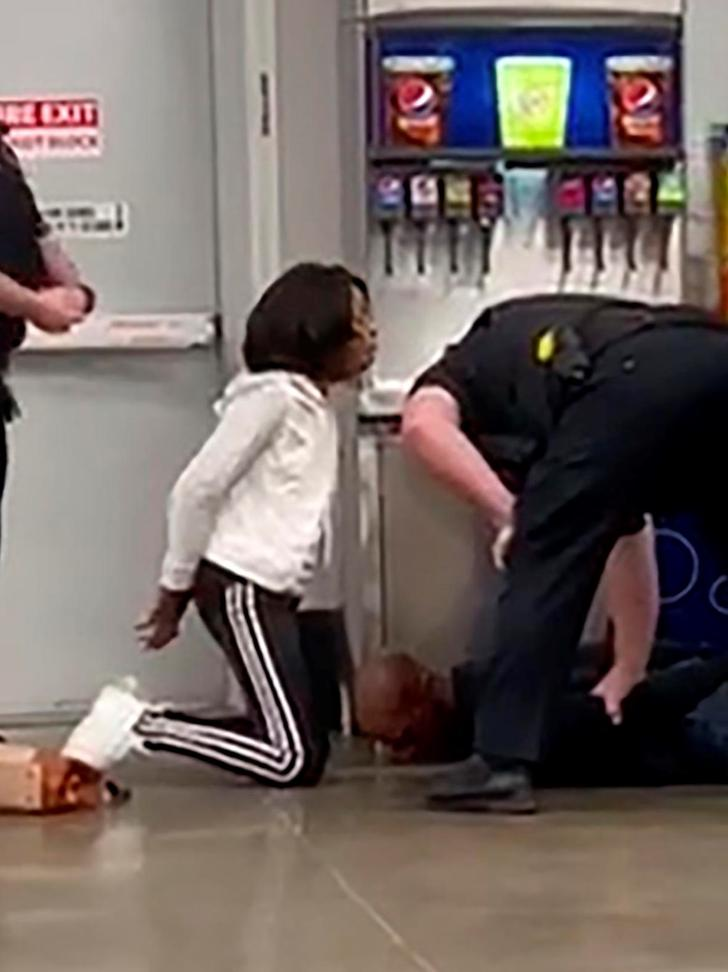 Marvia Gray (handcuffed) & son Derek and police