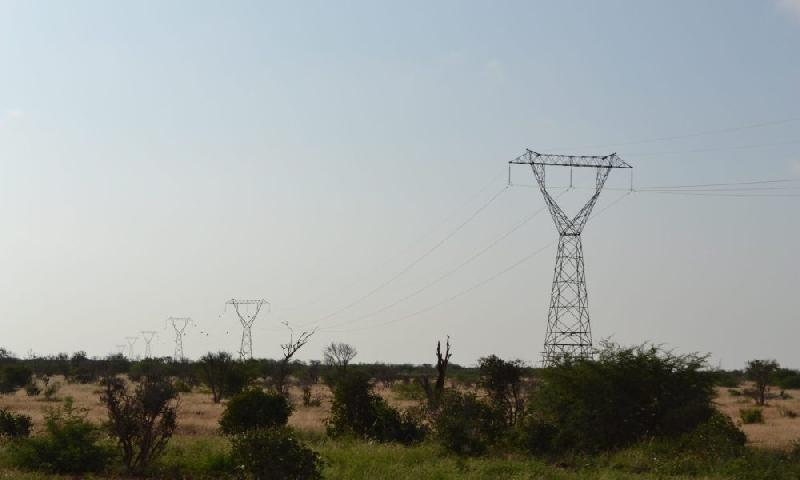 Electric_power_transmission_line_towards_the_south-east_in_the_Tsavo_East_National_Park_Kenya_2-scaled-1