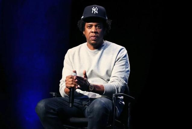 jay-z (sitting in chair - mic) - Getty