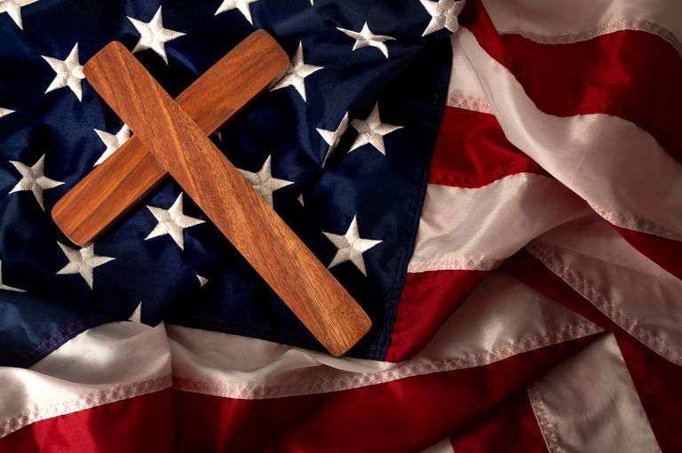 cross and flag - GettyImages-1141326791
