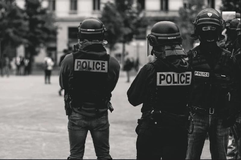 police - backs to camera