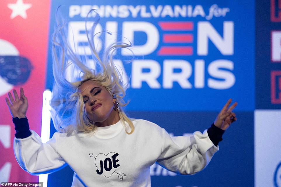 35175494-8907321-Lady_Gaga_dances_for_the_crowd_at_Monday_night_s_rally_for_Democ-a-52_1604372830381