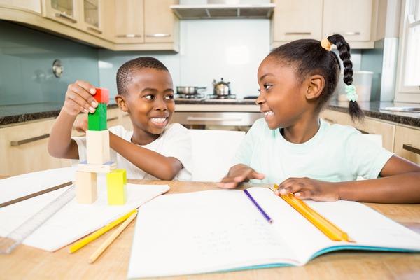 Black Children - doing homework - YayImages