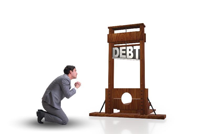 Debt Collection - businessman-in-heavy-debt-business-concept