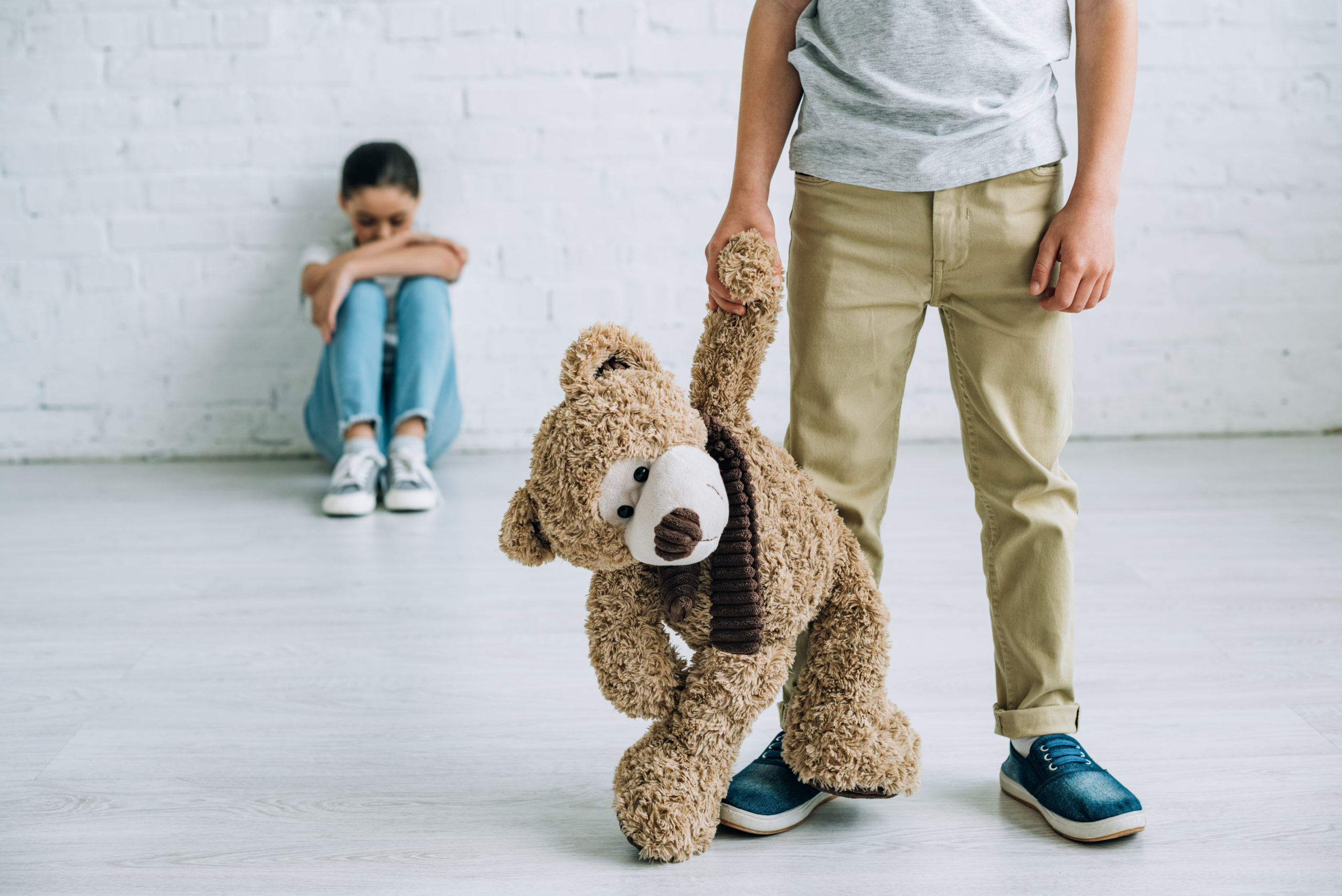 Man holding teddy bear - child in background - Depositphotos_266114350_xl-2015