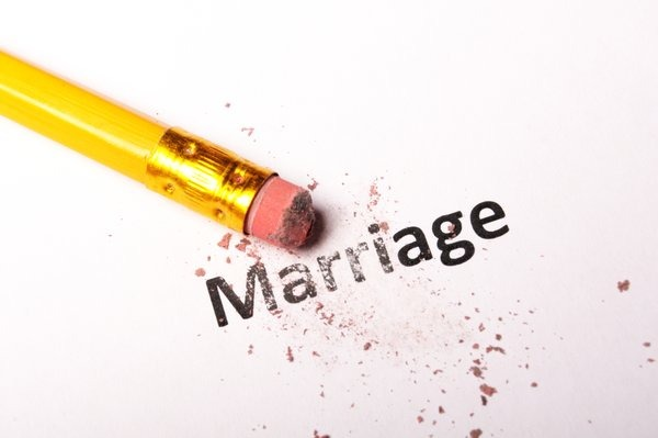 Divorce (pencil erasing the word marriage) - yayimages
