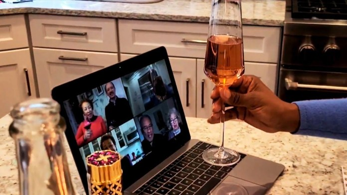 making a toast with people on Zoom