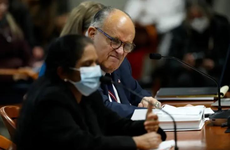 Rudy Giuliani wincing