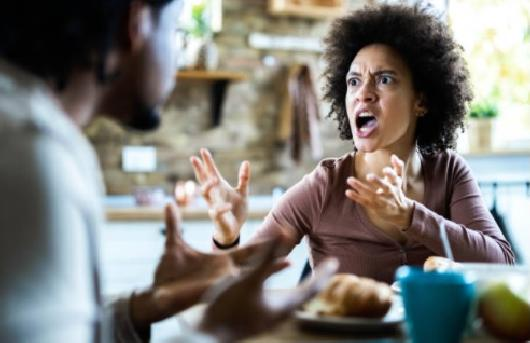 Upset woman talking to man - (Getty)