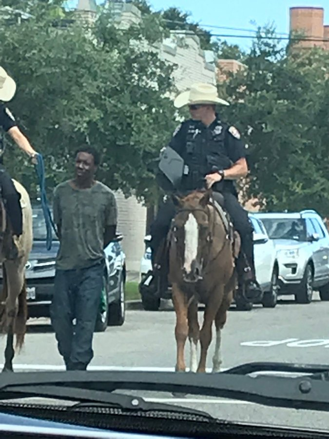 Donald Neely being led through Galveston streets by mounted officers.
