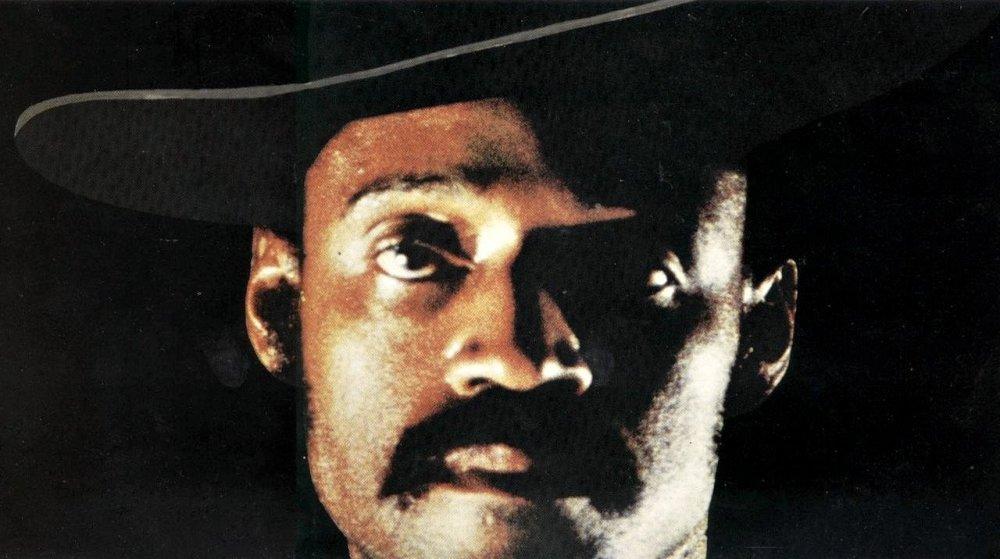 sweet-sweetbacks-baadasssss-song-1971-001-melvin-van-peebles-in-cowboy-hat-close-up-black-background_0