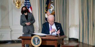 Joe Biden (Kamala Harris in bgrd) signing exec orders on race equity - Getty