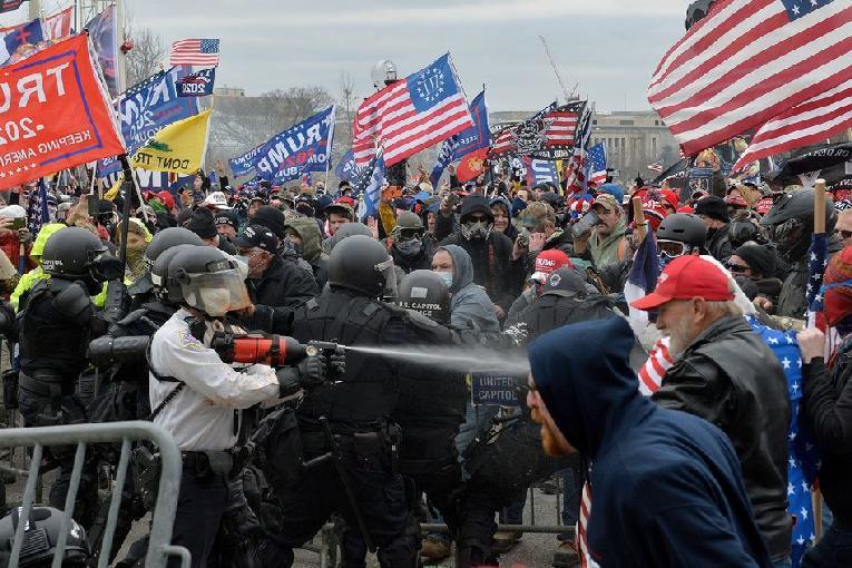 Riot at Capitol Bldg - gettyimages-1230454991_slide-da4b03ef3af357f3a9ac0776c9fa119316d5d62d