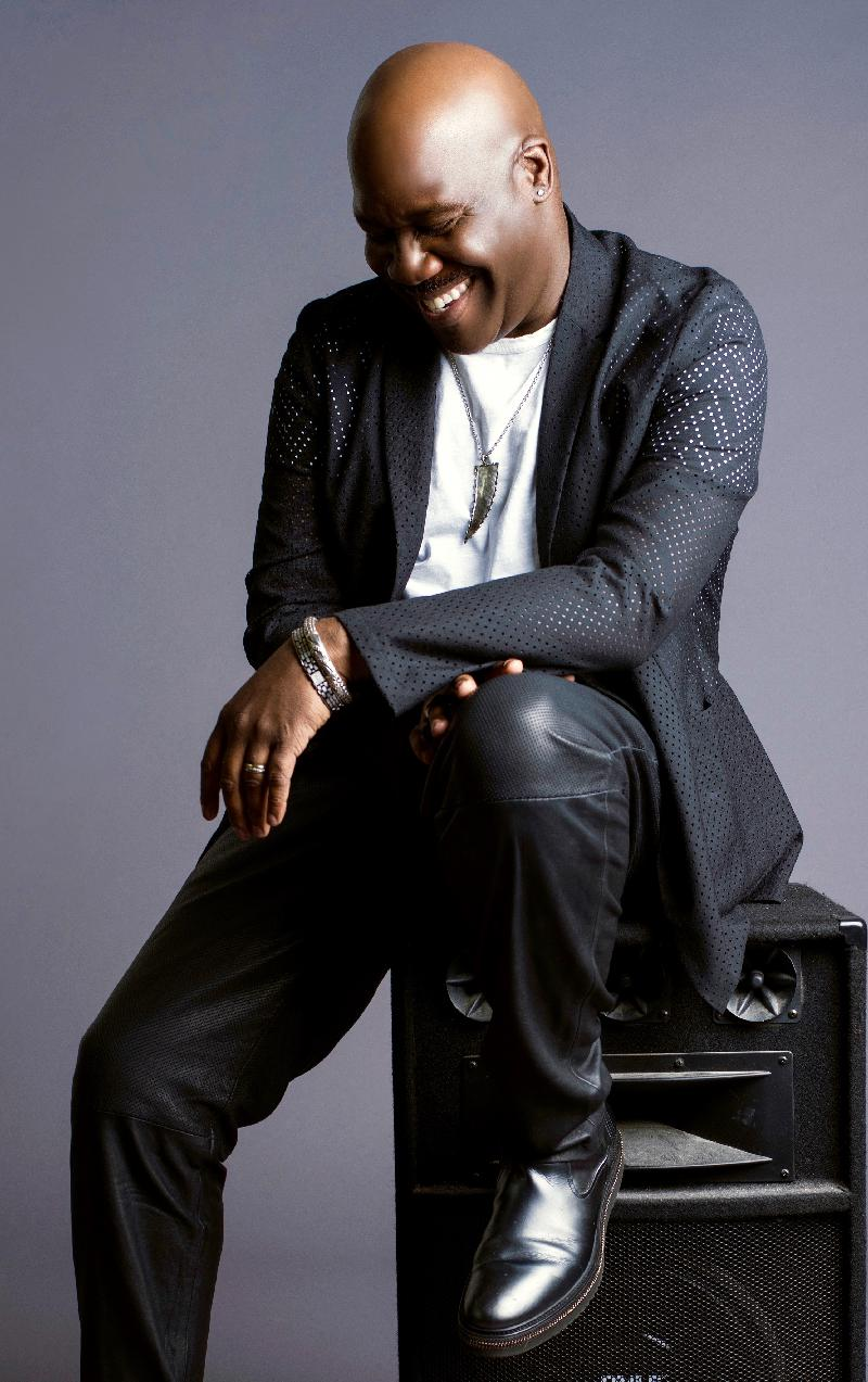Will Downing seated smiling