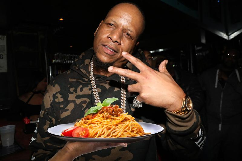 Kevin Hunter (with plate of Italian food - Getty)