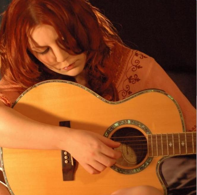 Shimmer Johnson on guitar