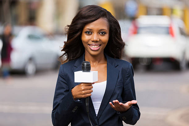 close up portrait of pretty african female news reporter in live broadcasting