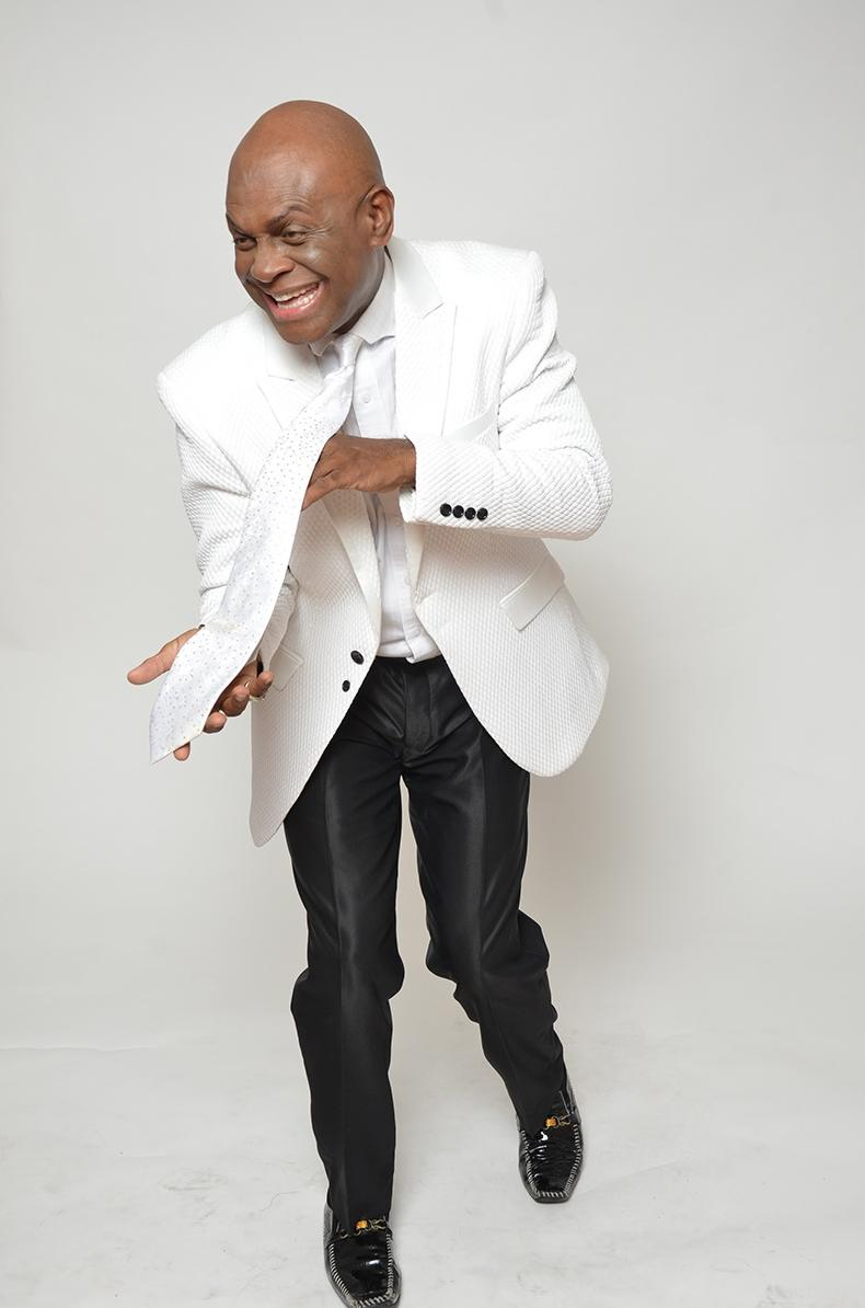 Michael Colyar in white jacket - black pants