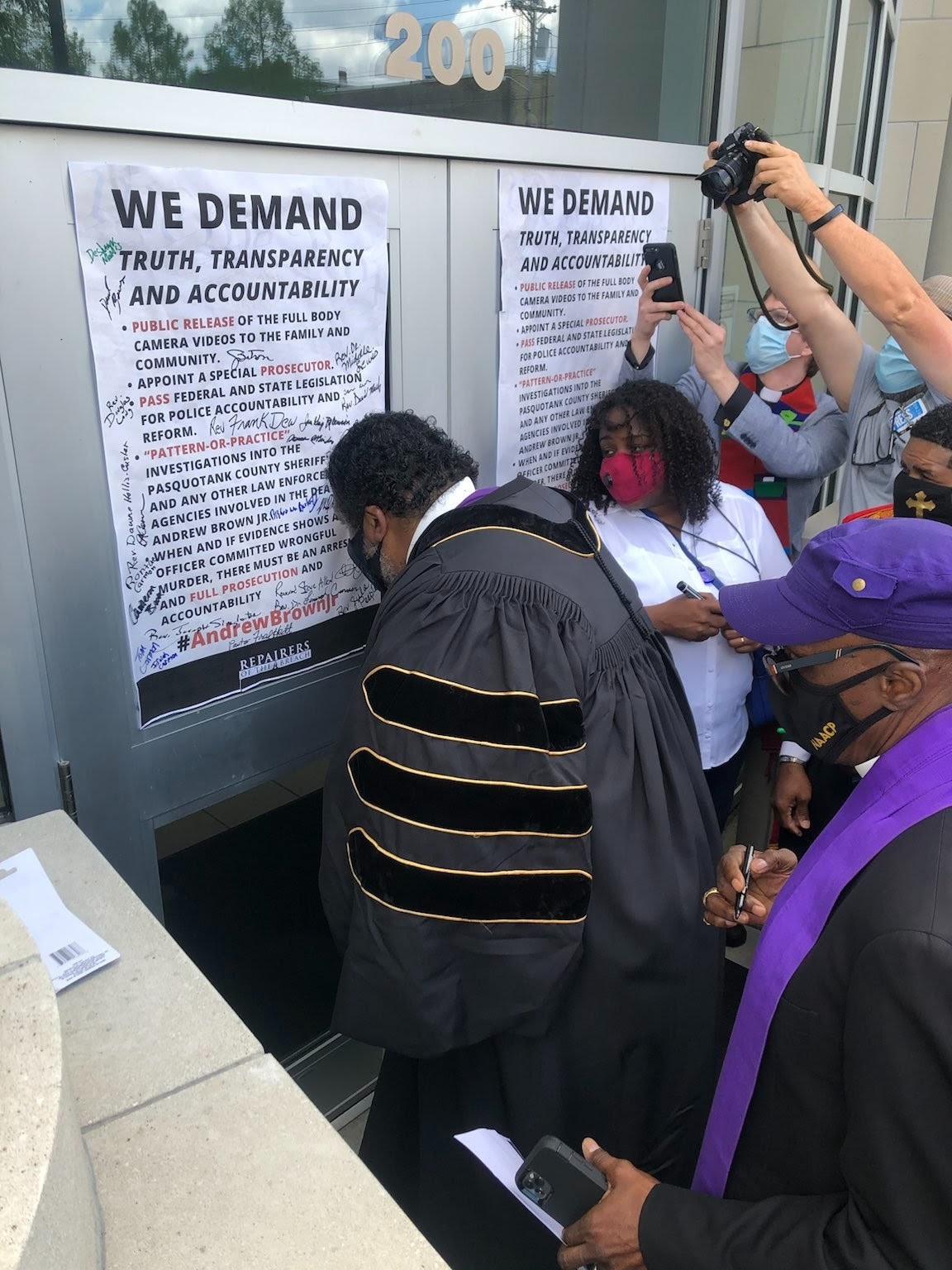 Bishop Barber signs We Demand
