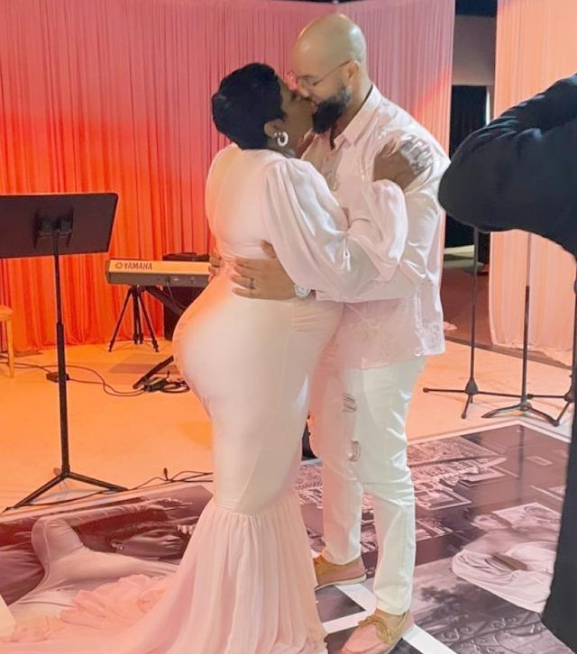 fantasia kissing husband in pink fishtail dress