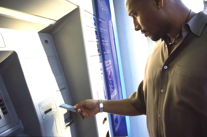 Black Man using ATM - GettyImages-88167803-5aa036c8a9d4f90036f04d17