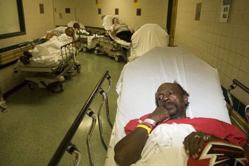 Black male patient in hospital corridor - GettyImages-986186011