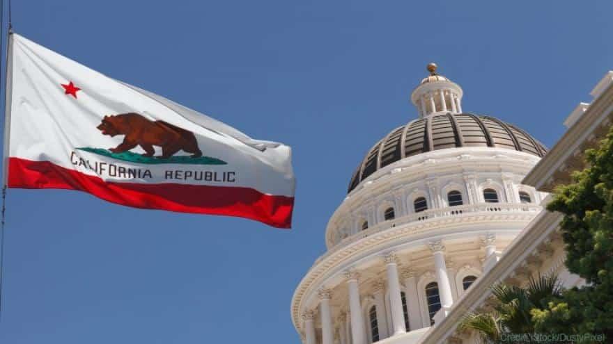 California capitol & flag - istock DustyPixel
