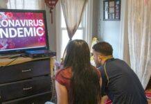 Coronavirus - couple watching TV (Getty)