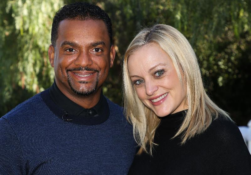 Alfonso Ribeiro & wife Angela / Getty