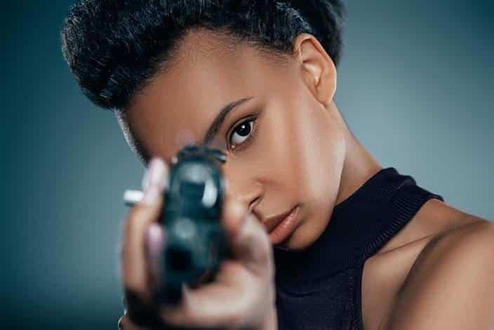 Black woman with gun (Getty)
