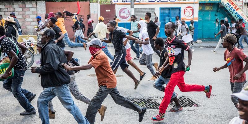 Haiti - people running